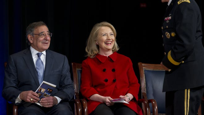 Leon Panetta and Hillary Clinton speak with then-chairman of the Joint Chiefs Martin Dempsey at the Pentagon in this 2013 photo.