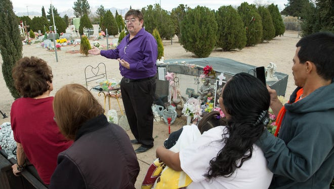 Orlando-Antonio Carrillo-Jimenez, leading a group in prayer at the grave of Baby Brianna on what would have been her 16th birthday. Feb. 14, 2018.