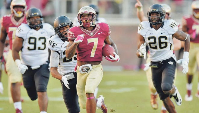 Florida State running back Mario Pender, an Island Coast High graduate, carries the ball on a 56-yard run against Wake Forest during the fourth quarter Saturday in Tallahassee.