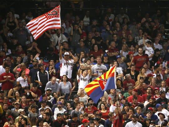 Arizona Diamondbacks fans cheer during opening day