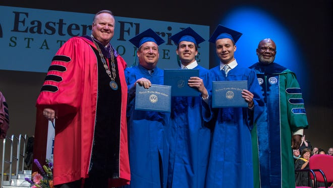 EFSC President Jim Richey, on the left, and EFSC Board of Trustees Chairman Moses L. Harvin Sr., on stage with Thomas, Chris and Nick Monteferrante: father and sons who graduated from Eastern Florida together.