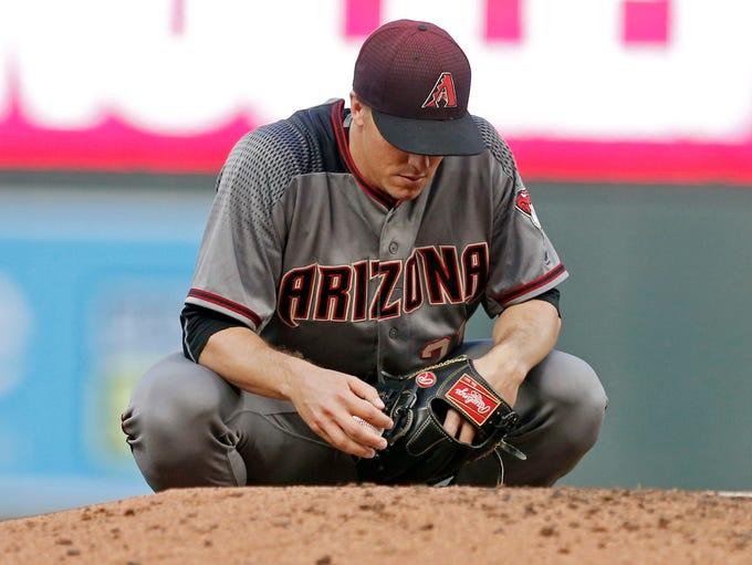 Arizona Diamondbacks pitcher Zack Greinke pauses for