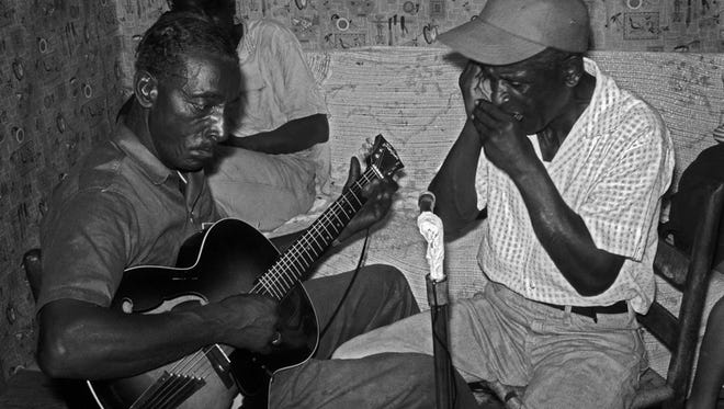"Fred McDowell on guitar, Johnny Woods on harmonica. McDowell is the subject of a new documentary, ""Shake 'Em on Down"" screening July 26 at Crosstown Arts."