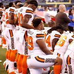 NFL kneels before its bottom line