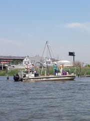 An EPA contractor's craft on the Hackensack River in the summer of 2016 collected sediment samples to determine levels of contamination.