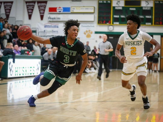 Des Moines North junior point guard Tyreke Locure drives