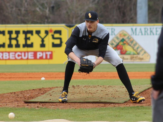 Southern Miss pitcher Walker Powell fields a ground