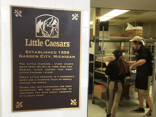 A commemorative plaque hangs at the original Little