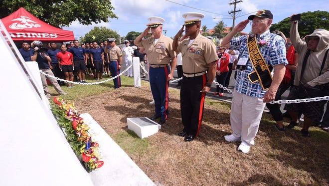 Marine Major Gen Craig Timberlake, center. 3rd Marine Expeditionary Forces, Okinawa renders a salute during a ceremony held before the 73rd Liberation Day Parade in Hagåtña, July 21, 2017.