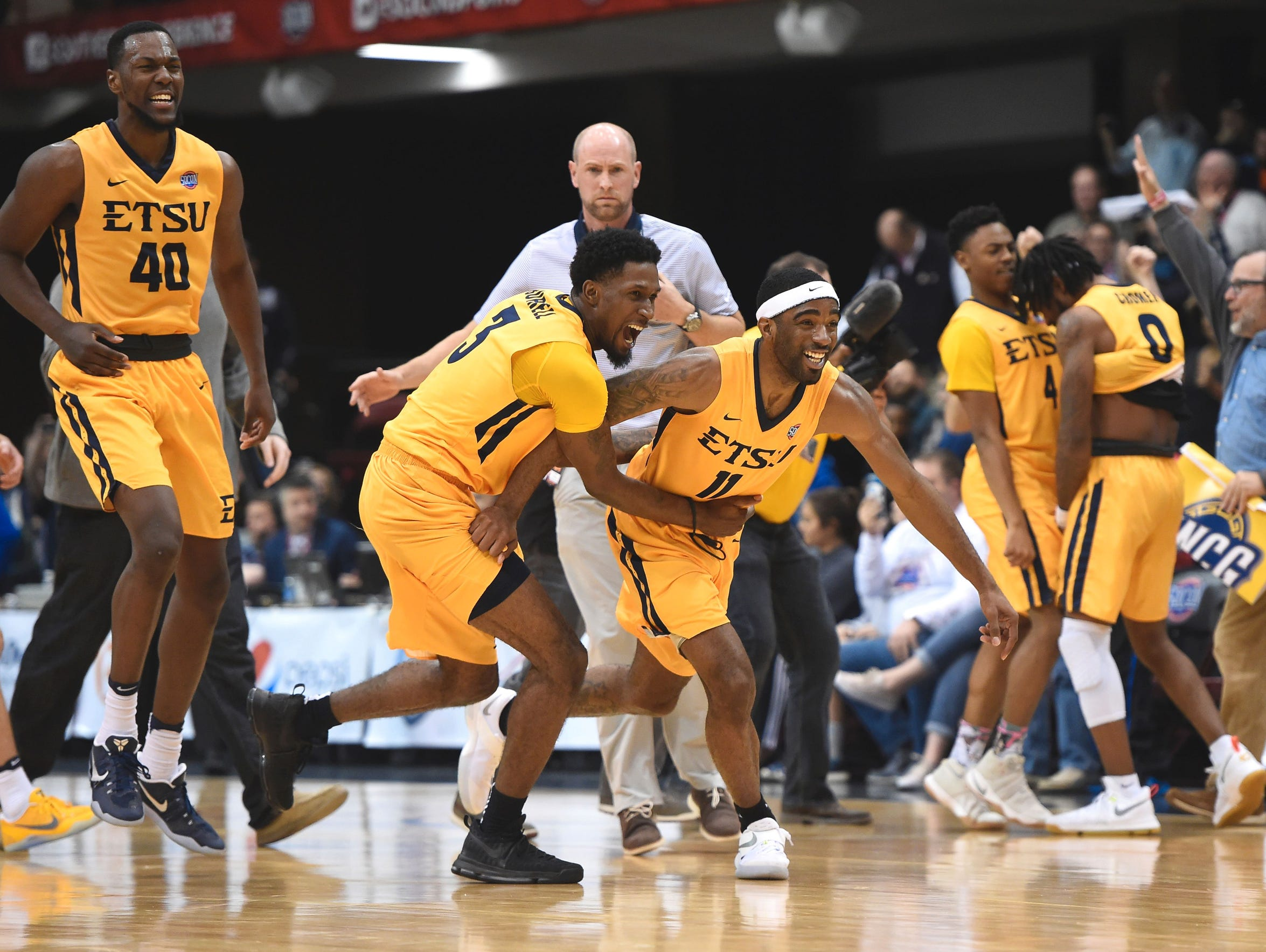 East Tennessee State's forwards Tevin Glass (40), David