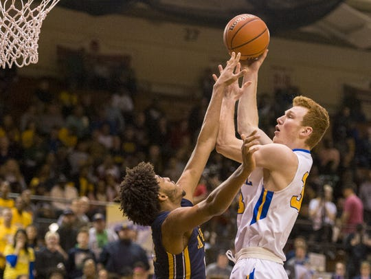 Carmel junior John Michael Mulloy (33) puts up a shot