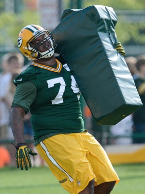 Green Bay Packers defensive end Carlos Gray runs a drill on the second day of Packers 2014 training camp at Ray Nitschke Field in Green Bay.