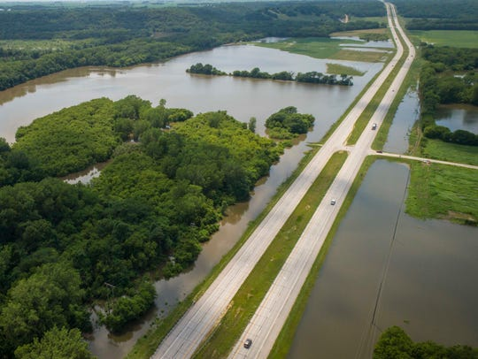 The Des Moines River is close to going over Highway