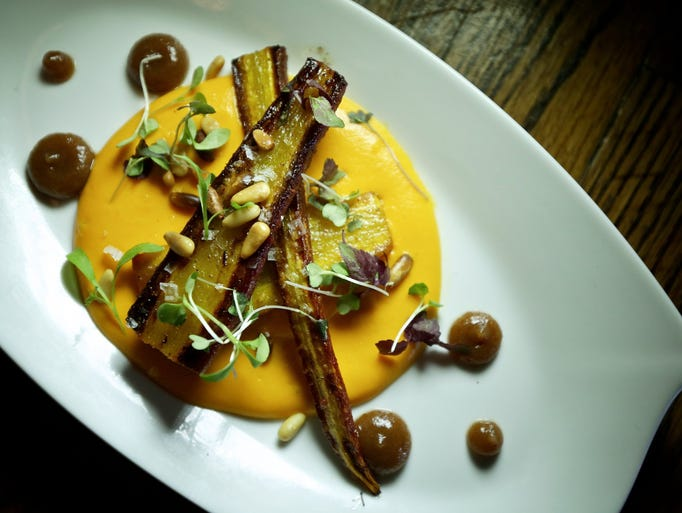 First course of Roasted Carrots, with cumin, date puree,