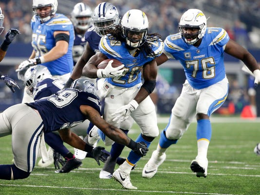 Dallas Cowboys linebacker Anthony Hitchens (59) attempts to stop Los Angeles Chargers running back Melvin Gordon (28) in the second half of an NFL football game, Thursday, Nov. 23, 2017, in Arlington, Texas. (AP Photo/Michael Ainsworth)