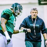 Kevin W. Fowler | for the Lansing State JournalMSU Strength and Conditioning Coach Ken Mannie (right) fist bumps defensive lineman Lawrence Thomas during a pre-Cotton Bowl practice Dec. 16 at the Duffy Daugherty Building in East Lansing. MSU Strength and Conditioning Coach Ken Mannie (right) fist bumps defensive lineman Lawrence Thomas during a pre-Cotton Bowl practice Tuesday December 16, 2014 at the Duffy Daugherty Building in East Lansing. KEVIN W. FOWLER PHOTO