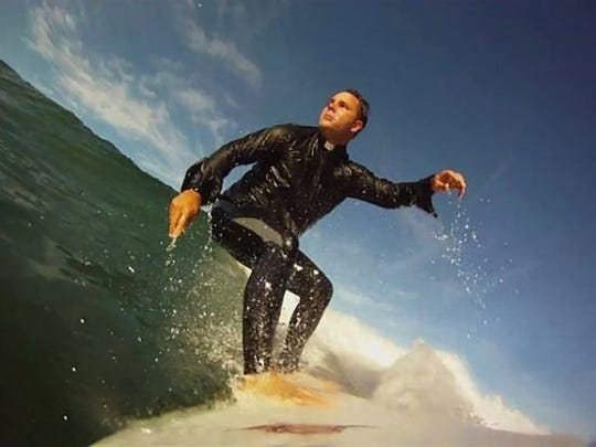"""Father Don Calloway, the """"Surfer Priest."""""""