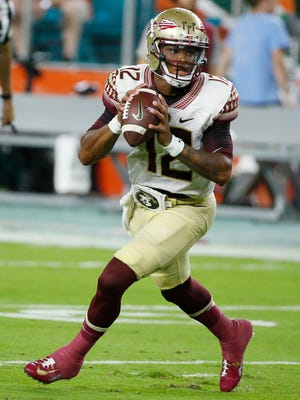 Florida State Seminoles quarterback Deondre Francois (12) looks to pass during the first half of an NCAA college football game against the Miami Hurricanes, Saturday, Oct. 8, 2016, in Miami Gardens, Fla. (AP Photo/Wilfredo Lee)