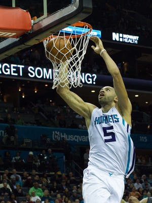 Nicolas Batum dunks during the second half at Time Warner Cable Arena.