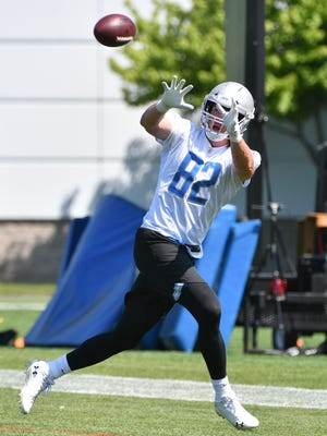 Lions tight end Luke Willson readies for a reception during OTAs.