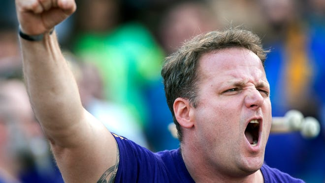 Ken Luther, now president of Louisville City FC supporters group The Coopers, roots on the club last Aug. 22.
