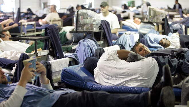 Inmates are seen in their bunk beds in an overcrowded Lancaster, Ohio correctional facility in 2009.