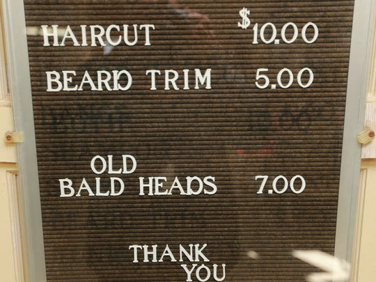 A sign inside Parkland Barber Shop informs customers about prices.