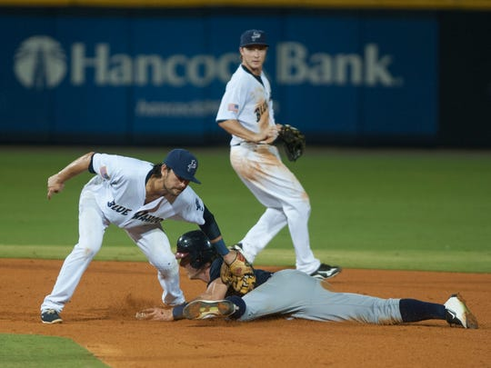 Shortstop Alex Blandino (5) tags out Connor Lien (5) at second base during the Mississippi Braves vs. Blue Wahoos baseball game at Blue Wahoos Stadium in Pensacola, FL on Wednesday, August 3, 2016.