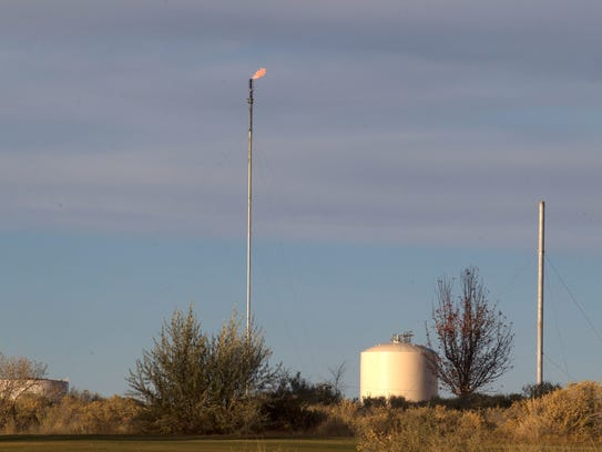 A flaring stack is pictured near Riverview Golf Course