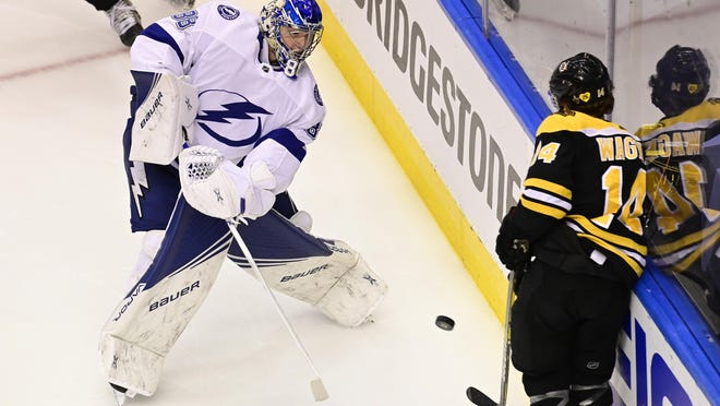 Bruins forward Chris Wagner tries to block the clearing attempt by Lightning goaltender Andrei Vasilevskiy during Game 3 of their second-round playoff series last week. Wagner missed Game 5 because of an elevated heart beat.
