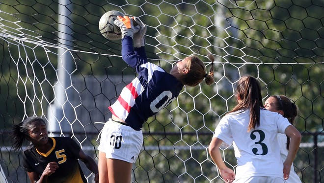 East Brunswick goalie Saba Sarwar leaps to make the stop against Piscataway on Tuesday.