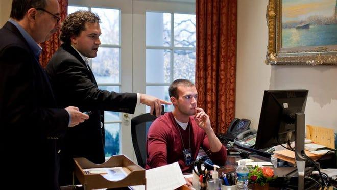 From left, senior advisor David Axelrod, speechwriter Cody Keenan and chief White House speechwriter Jon Favreau in 2011. Keenan started as an unpaid intern at the White House in 2007.