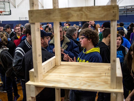 Andrew Caporuscio, 17, with the Richmond High School robotics team, gets a close look at field elements with his team during a reveal of the FIRST Robotics competition challenge Saturday, Jan. 7, 2017, at Capac High School.