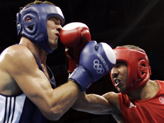American Andre Ward, from Oakland, Calif., right, lands his right on Belarus' Magomed Aripgadjiev during the light heavyweight boxing final in the 2004 Athens Summer Olympic Games in Athens.  Ward defeated Aripgadjiev to capture the gold medal.