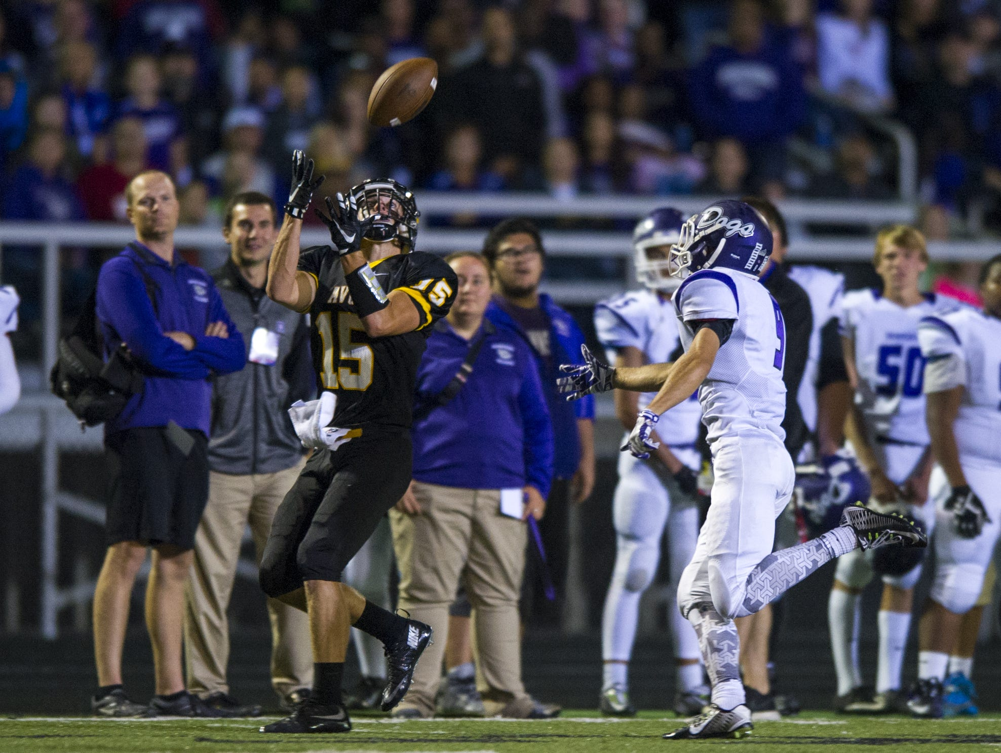 Avon WR Andrew Griffin (15) concentrates on the ball to complete the pass on Sept. 11, 2015.