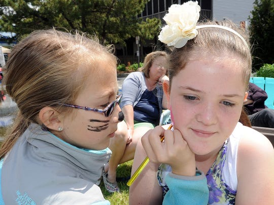 Rehoboth Elementary Schools, Marlee Geppart paints Daphne Branners face at Dewey Beach's 2nd Annual Art Festival that was held in 2013. The festival's fifth year kicks off May 7 at 9:30 a.m.