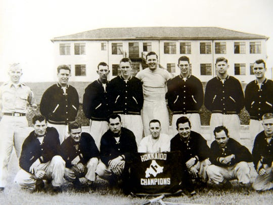 "A baseball team picture from Bob Flory's service in the Korean War. Flory, pictured in the second row, third from the left, is a Korean War veteran and recently received a Purple Heart he thought was stolen along with a Bronze Star and other medals he didn't know he qualified for. Even though he was injured in battle, he said he ""didn't give a rip"" for the medals and that there were others who sacrificed more than he did."