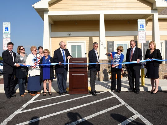 VIPs and invited guests are on hand during the Women In Need grand opening and ribbon cutting.
