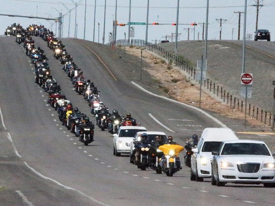 A long motorcycle procession rolls along Montana Ave to Evergreen East Cemetery at 12400 Montana during funeral services for Juan Martinez Jr., 61, of the Bandidos Motorcycle Club Saturday.