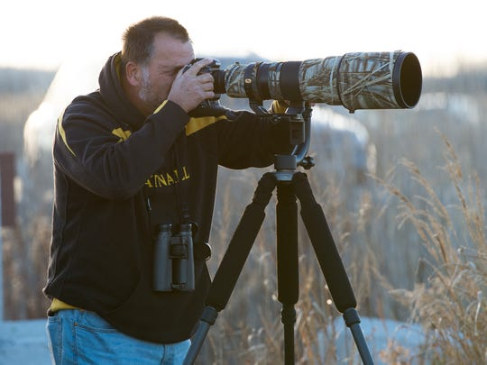 Hank Davis of Chadds Ford, Pa., looks for birds at Prime Hook National Wildlife Refuge.