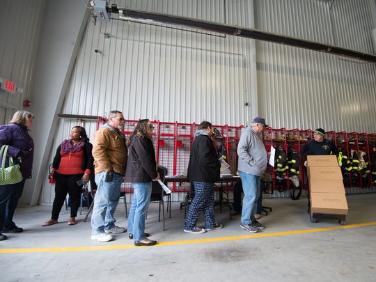 Residents of Blades wait in line to receive water at the Blades Volunteer Fire Company.  Elevated levels of PFCs were found in the public drinking water supply.