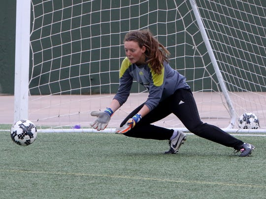 Rider goalkeeper Jordan McLarty makes a save against