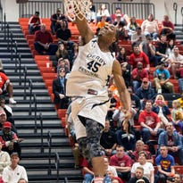 Crowd favorite and UofL recruit Donovan Mitchell participates in the dunk contest during the 2015 Kentucky Derby Festival Basketball Classic at New Albany High School on Friday night. 4/10/15