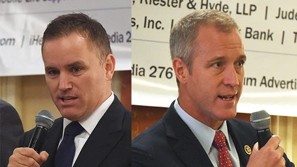 Rep. Sean Patrick Maloney, right, and challenger Phil Oliva, left, debate during the latest Dutchess County Regional Chamber of Commerce Contact Breakfast.
