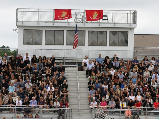 Mourners attend the funeral of Cpl. Daniel I. Baldassare, 20, of Colts Neck, a Marine who was killed July 10 when his military plane crashed in a soybean field in Mississippi, on the football field at Colts Neck High School in Colts Neck, NJ Tuesday, July 25, 2017.