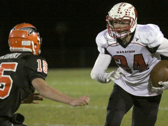 Marathon's Nathan Stoffel looks for room to run during a quarterfinal matchup against the Thunderbirds.