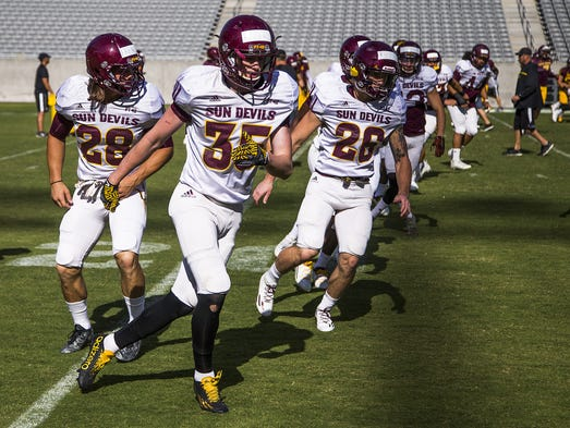 The Arizona State University football team practices