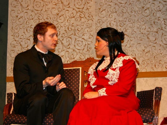 Bryan Henry plays Bob Cratchit and Victoria Heppard his future daughter-in-law Nell Watson in 'Resolutions: A Christmas Musical.'