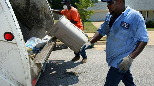 LaDarrell Cheatum, left, and Sam May collect garbage in Northport in 2007.