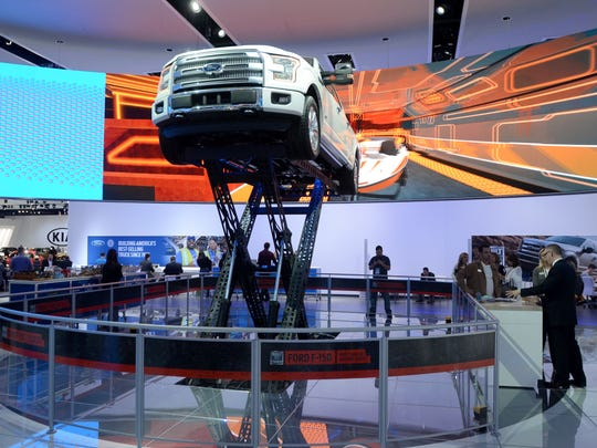 A Ford F-150 is raised up Tuesday, Jan. 12, during the North American International Auto Show at Cobo Hall.